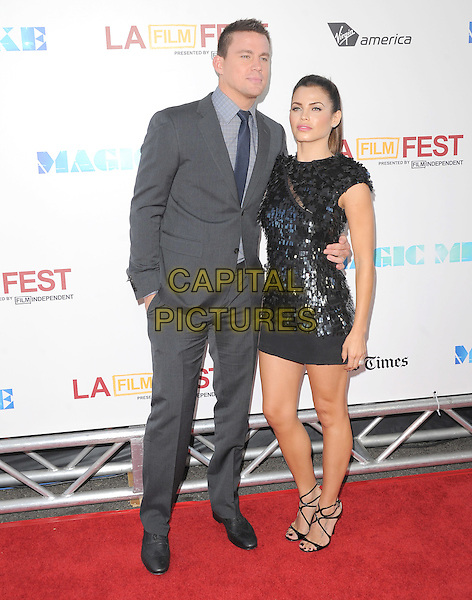 Channing Tatum and Jenna Dewan.World Premiere of 'Magic Mike' and Closing Night of Los Angeles Film Festival held at   The Regal Cinemas L.A. LIVE Stadium 14 in Los Angeles, California, USA..June 24th, 2012.LAFF full length grey gray suit black paillettes dress married husband wife arm around waist.CAP/RKE/DVS.©DVS/RockinExposures/Capital Pictures.