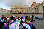 Pilgrims are seen on day before attending the double canonisation of late Popes John Paul II and John XXIII presided over by Pontiffs Pope Francis and his elderly predecessor Benedict XVI at St Peter's square in Rome.  <br /> <br /> &copy; Pierre Teyssot