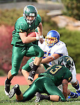 SPEARFISH SD -- OCTOBER 4 -- Tanner Ehrlich #5 of Black Hills State hops over teammate Clint Nicholes #43 as he keeps Dana Felderman #57 of Dakota State out of the play during their game Saturday at Lyle Hare Stadium in Spearfish, S.D. (Photo by Dick Carlson/Inertia)