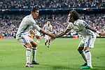 Cristiano Ronaldo of Real Madrid celebrates with teammate Marcelo Vieira Da Silva during their 2016-17 UEFA Champions League Quarter-finals second leg match between Real Madrid and FC Bayern Munich at the Estadio Santiago Bernabeu on 18 April 2017 in Madrid, Spain. Photo by Diego Gonzalez Souto / Power Sport Images