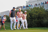 Daniel Berger (USA) talks to Phil Mickelson (USA) and Kevin Kisner (USA) on their way down 17 during round 2 Four-Ball of the 2017 President's Cup, Liberty National Golf Club, Jersey City, New Jersey, USA. 9/29/2017.<br /> Picture: Golffile | Ken Murray<br /> <br /> All photo usage must carry mandatory copyright credit (&copy; Golffile | Ken Murray)