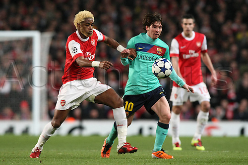 16.02.2011 Arsenal staged a brilliant late comeback to claim a 2-1 win and give themselves a real chance of progressing in the Champions League. Picture shows Lionel Messi and Alex Song challenging for the ball.