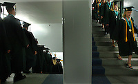 Pine Ridge High School graduates walk in line to begin the graduation ceremonies for the Class of 2004 Sunday afternoon, May 23, 2004 at the Ocean Center in Daytona Beach, Florida.(AP Photo/Daytona Beach News-Journal, kelly Jordan)