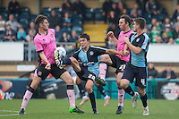 Goal scorer Luke O'Nien of Wycombe Wanderers takes on Shaun Brisley (left) of Northampton Town & John-Joe O'Toole of Northampton Town during the Sky Bet League 2 match between Wycombe Wanderers and Northampton Town at Adams Park, High Wycombe, England on 3 October 2015. Photo by Andy Rowland.