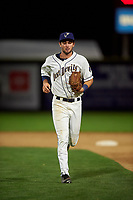 Tri-City Dust Devils left fielder Jack Stronach (51) jogs off the field between innings of a Northwest League game against the Vancouver Canadians at Gesa Stadium on August 21, 2019 in Pasco, Washington. Vancouver defeated Tri-City 1-0. (Zachary Lucy/Four Seam Images)