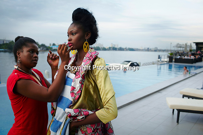 LAGOS, NIGERIA MAY 29: Fifteen year old model Favour Lucky has make up done while before a photo shoot at Radisson Blu hotel on May 29, 2013 in Lagos, Nigeria. Favour won Nigeria's next supermodel when she was fourteen years old. She has modeled in Johannesburg, Cape Town, New York and Atlanta. (Photo by: Per-Anders Pettersson)