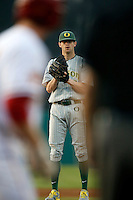 Jake Reed #5 of the Oregon Ducks pitches against the USC Trojans at Dedeaux Field on March 15, 2013 in Los Angeles, California. (Larry Goren/Four Seam Images)