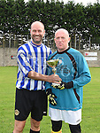 Laurence Centre team captain Jack Doyle and Peaches team captain Barry Higgins with the Alzheimers Cup at Marion Park. Photo:Colin Bell/pressphotos.ie