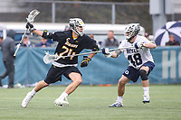 Washington, DC - February 23, 2019: Towson Tigers Brendan Sunday (24) holds off Georgetown Hoyas Stephen MacLeod (48) during game between Towson and Georgetown at  Cooper Field in Washington, DC.   (Photo by Elliott Brown/Media Images International)