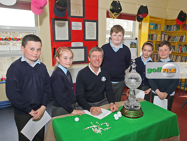 Des Smyth signs autographs during his visit to Cornanool NS Castlebar with from left: Nathan Wlsh, Eimear Ruane, Cathal O'Boyle,  Lauren Courell and Sean Collins. Photo: &copy; Michael Donnelly<br /> Picture: Golffile | Michael Donnelly<br /> <br /> All photo usage must carry mandatory copyright credit (&copy; Golffile | Michael Donnelly)