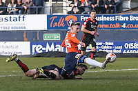 Joe Pigott of Luton Town (right) gets his foot to the ball as team mates appeal for a penalty during the Sky Bet League 2 match between Luton Town and Crawley Town at Kenilworth Road, Luton, England on 12 March 2016. Photo by David Horn/PRiME Media Images.