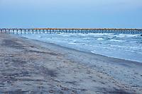 Fishing pier and ocean waves at Atlantic Beach, located along the Crystal Coast of North Carolina