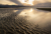 Sunset at low tide on Pohara beach, Golden Bay, New zealand