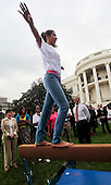 Washington, DC - September 16, 2009 -- United States President Barack Obama (R), his wife Michelle (2L) and Senior Advisor Valerie Jarrett watch a Balance Beam demonstration  during an event on Olympics, Paralympics and Youth Sport Canadian on the South Lawn of the White House, Washington, DC, September 16, 2009. .President Obama and his wife Michelle support the candidacy of Chicago as the city host for the Summer Olympic Games 2016..Credit: Aude Guerrucci / Pool via CNP