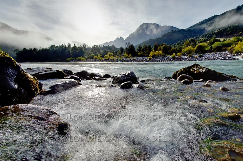 Morning fog lifts and the Nuns appear,  Mapu Leufu Camp, Rio Futaleufu, Patagonia, Chile, South America