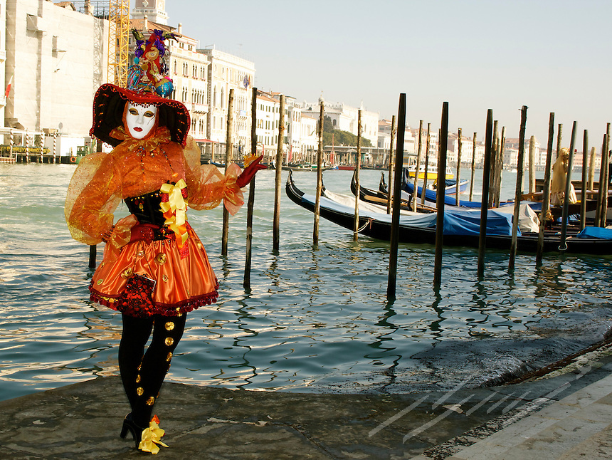 Models pausing in costumes everywhere in Venice Carnival, Italy.