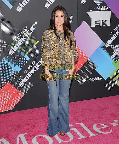 ALEXA VEGA .at The T-Mobile Sidekick 4G Launch Party held at a private lot in Beverly Hills, California, USA, April 20th 2011..full length top blouse jeans wide leg clutch bag yellow black print .CAP/RKE/DVS.©DVS/RockinExposures/Capital Pictures.