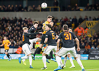 4th January 2020; Molineux Stadium, Wolverhampton, West Midlands, England; English FA Cup Football, Wolverhampton Wanderers versus Manchester United; Leander Dendoncker of Wolverhampton Wanderers leaps to head the ball surrounded by Manchester United players - Strictly Editorial Use Only. No use with unauthorized audio, video, data, fixture lists, club/league logos or 'live' services. Online in-match use limited to 120 images, no video emulation. No use in betting, games or single club/league/player publications