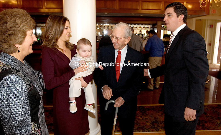 TORRINGTON CT. 30 March 2014-033014SV09-Former Mayor Ryan Bingham, right, with his mom Anne Ruwet, left, his wife Jen, son Blake, 6 months, and his grandfather Joe Ruwet greet guests during a Republican Town Committee brunch for the former mayor at the Elks Club in Torrington Sunday.<br /> Steven Valenti Republican-American