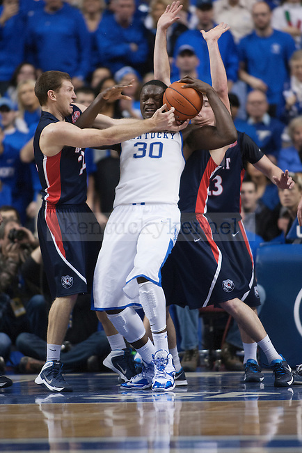 UK forward Julius Randle fights over Belmont defenders during the first half of the University of Kentucky men's basketball game vs. Belmont University at Rupp Arena in Lexington, Ky., on Saturday, December 21, 2013. Kentucky defeated Belmont 93-80. Photo by Michael Reaves | Staff.