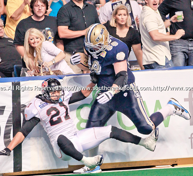 Aug 14, 2010: Tampa Bay Storm center Robert Powell (#68) knocks over Orlando Predator defensive back Dion Byrom (#21) on his way to a touchdown. The Storm defeated the Predators 63-62 to win the division title at the St. Petersburg Times Forum in Tampa, Florida. (Mandatory Credit:  Margaret Bowles)
