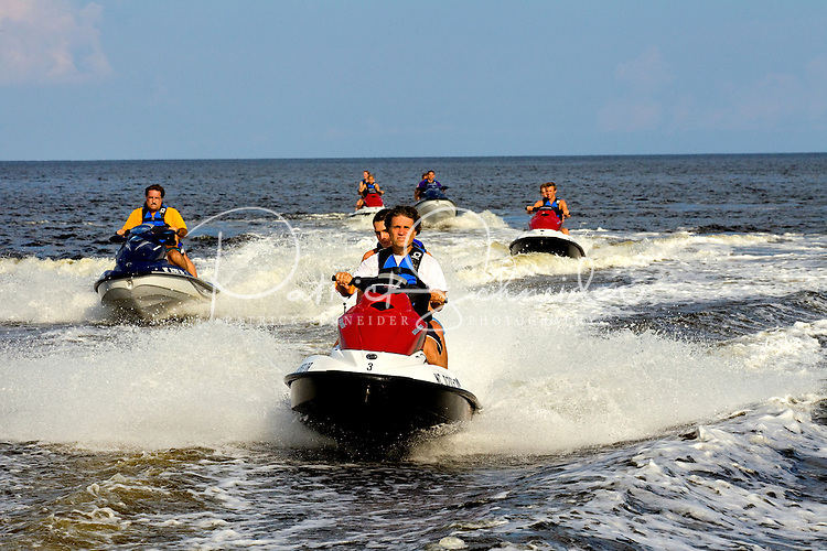 Members of a Venturing Crew take Seadoos for a spin during camp. Photo is part of a series of images taken at Pamlico Sea Base, a Boy Scouts of America High Adventure Camp located on the Pamlico River south of Washington, NC. The BSA Sea Base program is centered around sea kayaking treks on the North Carolina Outer Banks and sailing programs on the historic Pamlico River...Photography by: Patrick Schneider Photo.com