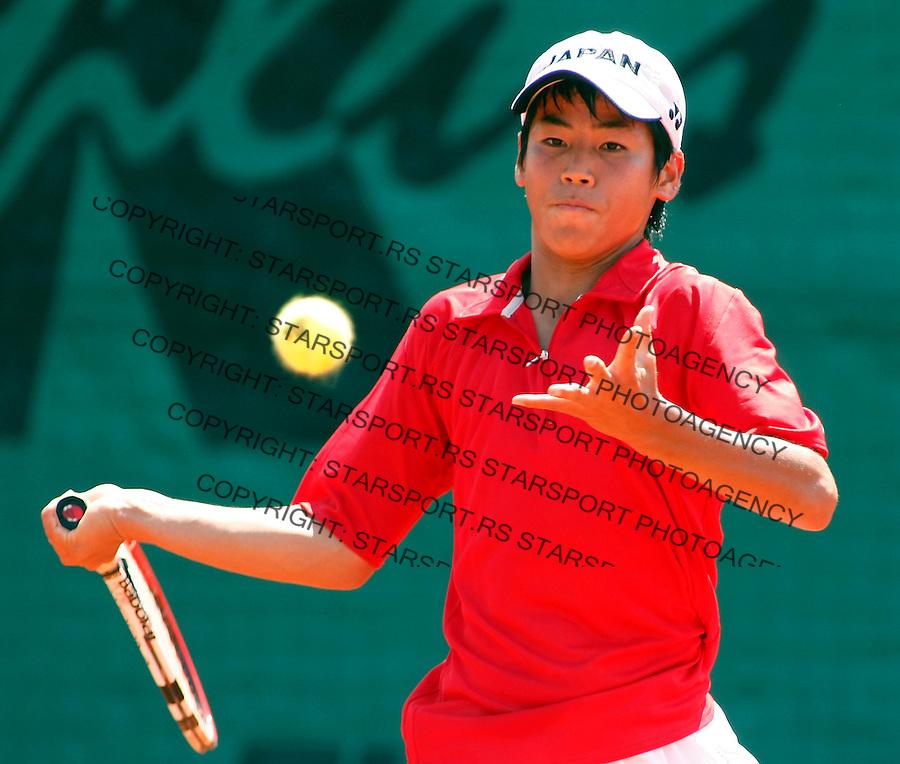 Tenis, World Championship U-14.Japan-France.Ken Onishi Vs. Quentin Halys.Ken Onishi, returnes.Prostejov, 02.08.2010..foto: Srdjan Stevanovic/Starsportphoto ©