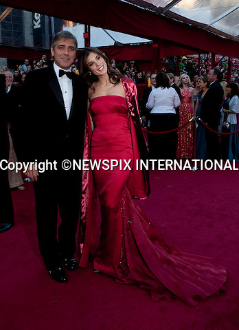 """OSCARS 2010 RED CARPET ARRIVALS_GEORGE CLOONEY AND GIRLFRIEND ELISABETTA CANALIS.The 82nd Academy Awards  arrivals took place under a transparent tent to keep the red carpet dry from the pending rain_ Kodak Theatre, Hollywood, Los Angeles_07/03/2009.Mandatory Photo Credit: ©Dias/Newspix International..**ALL FEES PAYABLE TO: """"NEWSPIX INTERNATIONAL""""**..PHOTO CREDIT MANDATORY!!: NEWSPIX INTERNATIONAL(Failure to credit will incur a surcharge of 100% of reproduction fees)..IMMEDIATE CONFIRMATION OF USAGE REQUIRED:.Newspix International, 31 Chinnery Hill, Bishop's Stortford, ENGLAND CM23 3PS.Tel:+441279 324672  ; Fax: +441279656877.Mobile:  0777568 1153.e-mail: info@newspixinternational.co.uk"""