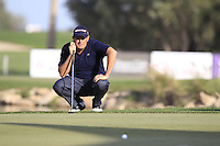 Anthony Wall (ENG) lines up his putt on the 18th green during Friday's Round 3 of the Commercial Bank Qatar Masters 2013 at Doha Golf Club, Doha, Qatar 25th January 2013 .Photo Eoin Clarke/www.golffile.ie
