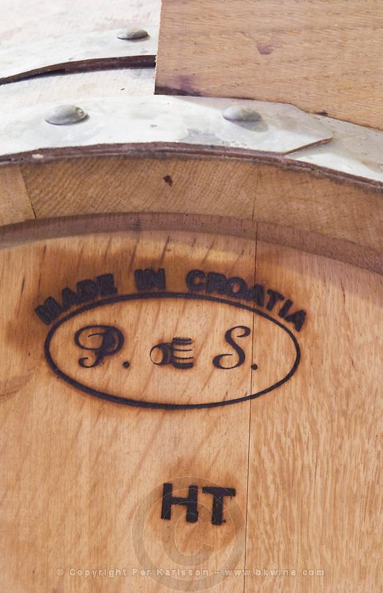 Wooden barrel with stamp saying Made in Croatia P S HT, code for high toast on Croatian barrique. Matusko Winery. Potmje village, Dingac wine region, Peljesac peninsula. Matusko Winery. Dingac village and region. Peljesac peninsula. Dalmatian Coast, Croatia, Europe.