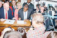 Republican presidential candidate Dr. Ben Carson officially files his presidential candidacy in the New Hampshire State House in Concord, New Hampshire. At left is New Hampshire Secretary of State Bill Gardner.