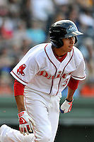 Shortstop Javier Guerra (31) of the Greenville Drive runs out a double in the first inning of a game against the Augusta GreenJackets on Thursday, July 16, 2015, at Fluor Field at the West End in Greenville, South Carolina. Guerra is the No. 13 prospect of the Boston Red Sox, according to Baseball America. Greenville won, 11-5. (Tom Priddy/Four Seam Images)