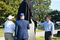 NWA Democrat-Gazette/CHARLIE KAIJO Jim White, director of Rogers Parks and Recreation (from left); Shane Pair, Lt. Col. Chaplain Arkansas National Guard Joint Force Headquarters and Michael Parker, president of Nabholz Construction unveil a new monument during a dedication ceremony, Monday, September 9, 2019 at the Rogers cemetery in Rogers.<br /> <br /> The Rogers Cemetery held a dedication ceremony for its new monument.