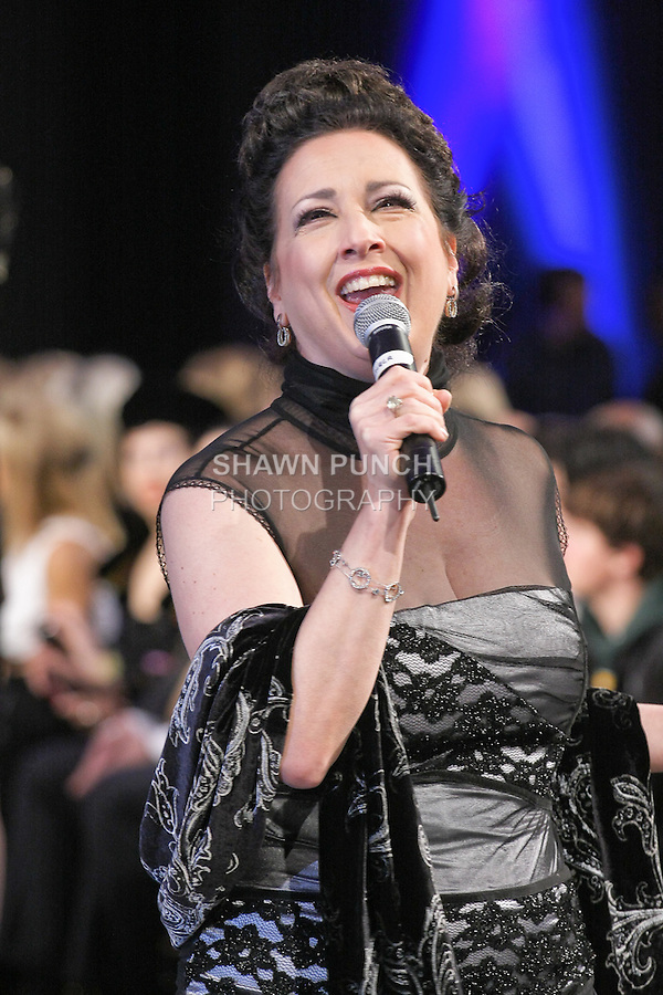 Soprano singer Cristina Fontanelli, performs during Couture Fashion Week Fall 2011 in New York City.