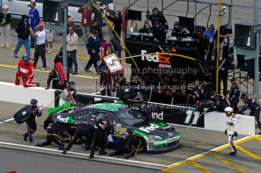 Denny Hamlin, (#11) FedEx Ground Camry, makes a pit stop.