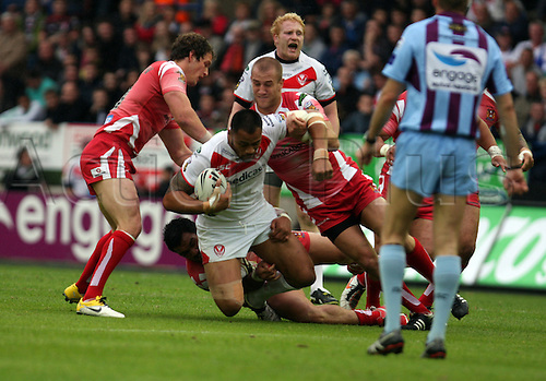 17.06.2011. Widnes, Cheshire.  Engage Super League Rugby . St Helens v Wigan. Francis Meli  is tackled by Lee Mossop . The final score was St Helens 10-32 Wigan