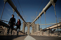 An Indian visitor poses for a picture at the brooklyn bridge in New York, United States. 11/01/2012. Officials announced the arrival of the record-breaking 50 millionth visitor of the year. Photo by Kena Betancur / VIEWpress.