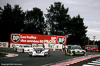 LE MANS, FRANCE: The winning Porsche 956 002 of Jacky Ickx and Derek Bell passes slower traffic in the Mulsanne Corner during the 24 Hours of Le Mans on June 20, 1982, at Circuit de la Sarthe in Le Mans, France.