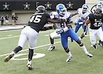 UK wide receiver Javess Blue gets tackled by Vanderbilt fullback Joseph Hoffman during the second half of the University of Kentucky vs. Vanderbilt University football game at Vanderbilt Stadium in Nashville, Tenn., on Saturday, November 16, 2013. Vanderbilt won 22-6. Photo by Tessa Lighty | Staff