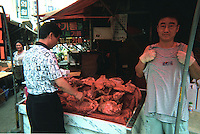 FILE PHOTO: DOG MEAT: SEOUL:  SOUTH KOREA<br />  A store owner displays a korea 2002 World Cup vest next to his stall selling dog meat in a market in downtown Seoul South Korea.  South korea will be jointly hosting the World Cup this year and the eating of dog meat is a sensitive issue the authorities would rather people did not know about.<br /> CREDIT MUST READ ANIMALS ASIA / SINOPIX