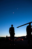 United States President Barack Obama stops to view the moon and Venus before boarding Marine One in Boulder, Colorado, April 24, 2012. .Mandatory Credit: Pete Souza - White House via CNP
