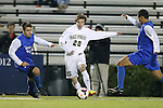 25 October 2013: Wake Forest's Hunter Bandy (20) is tracked by Duke's Rob Dolot (24) and Luis Rendon (right). The Duke University Blue Devils hosted the Wake Forest University Demon Deacons at Koskinen Stadium in Durham, NC in a 2013 NCAA Division I Men's Soccer match. The game ended in a 2-2 tie after two overtimes.