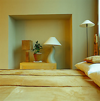 In a guest bedroom tones of sand and yellow ochre create an atmosphere of warmth and comfort