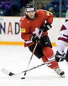 Lukas Stoop (Switzerland - 7) - Team Switzerland defeated Team Latvia 7-5 on Wednesday, December 30, 2009, at the Credit Union Centre in Saskatoon, Saskatchewan, during the 2010 World Juniors tournament.