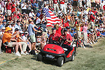 Paul Azinger drives by the sea of red  after Hunter Mahon halving the hole on the 18th during the final round of Single Matches at The 37th Ryder cup from Valhalla Golf Club in Louisville, Kentucky....Photo: Fran Caffrey/www.golffile.ie.