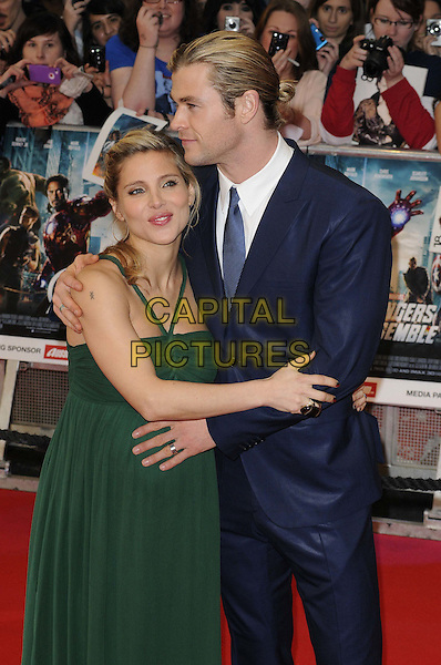 Elsa Pataky and Chris Hemsworth.'Marvel Avengers Assemble' European film premiere at Vue cinema, Westfield, London, England..19th April 2012.half length blue suit white shirt green dress pregnant couple arms around profile .CAP/CAN.©Can Nguyen/Capital Pictures.