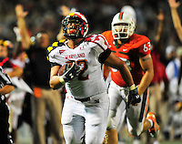 The Terrapins' Joe Vellano intercepts the ball for a touchdown to give his team the lead before halftime. Maryland defeated Miami 32-24 during a game at the Byrd Stadium in College Park, MD on Monday, September 5, 2011. Alan P. Santos/DC Sports Box