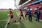 Ennis captain Jack Colleran leads out his team before their U-18 Munster Club Final against Garryowen at Thomond Park. Photograph by John Kelly.
