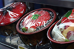 Apr 10, 2010 - Tokyo, Japan - Imitation sushi damburi are displayed at a restaurant supply store located in Kappabashi street in Tokyo on April 10, 2010. Kappabashi-dori, also known just as Kappabashi or Kitchen Town, is almost entirely populated with shops supplying mass-produced crockery, restaurant furniture, ovens and decorations, through to esoteric items such as the plastic display food  (sampuru). Replica foods are also popular as souvenirs for tourists.