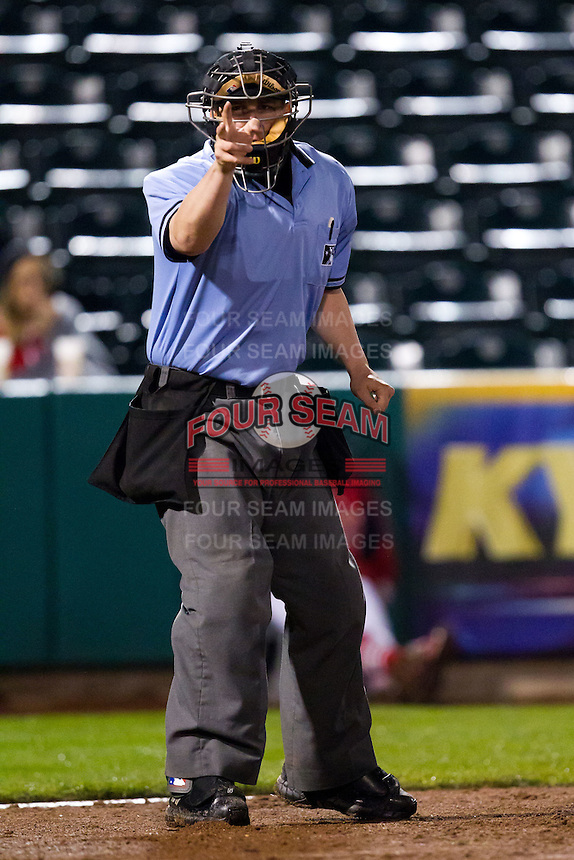 Home Plate Umpire Gabriel Morales calls a strike during a game between the Springfield Cardinals and Northwest Arkansas Naturals on May 13, 2011 at Hammons Field in Springfield, Missouri.  Photo By David Welker/Four Seam Images.
